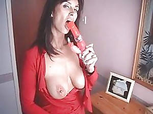 All red MILF bonks herself with a couple of hyper heeled footwear