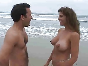 MILF with giant bazookas fucking in the shore front